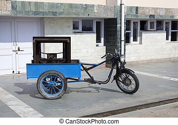 auto rickshaw - a motorcycle modified to make an auto...
