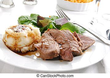 Sliced roast beef dinner