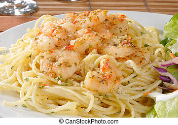 Shrimp scampi on pasta - Close up of a plate of pasta topped...