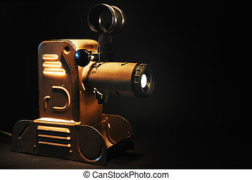vintage slide projector with the light in dark room