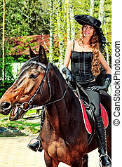 equitation ride - Beautiful young woman in medieval costume...