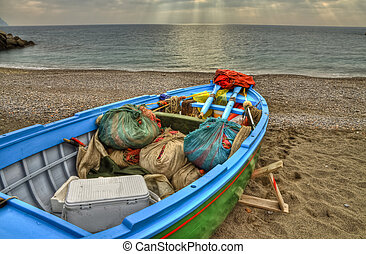 Fishing boat on the beach of Atrani (SA) containing the...