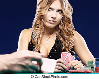 Woman doubt in a card gambling match - Blond woman doubt in...