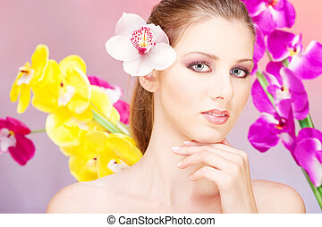 Pretty woman in front of  flowers