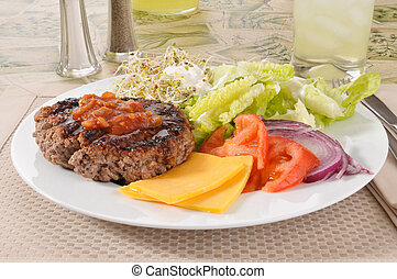 Low calorie lunch - A lean broiled ground beef patty with...