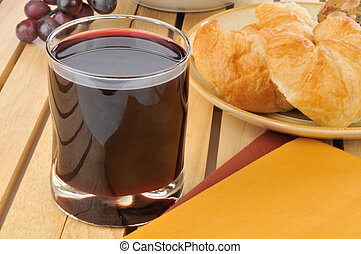 Grape juice - Glass of grape juice with croissants