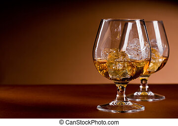 Whiskey on the rocks - photo of delicious glass of cognac...