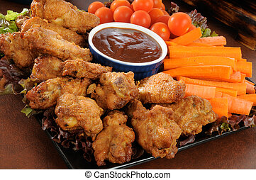 Buffalo wings snack tray - A snack tray with buffalo wings,...