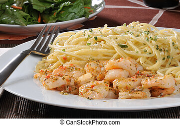 Shrimp scampi with pasta - A plate of shrimp scampi with...