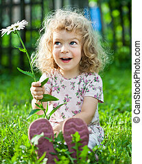 Child with flower - Happy smiling child playing outdoors in...