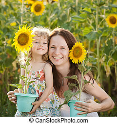 Woman and child with sunflower - Beautiful woman and child...