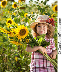 Child with bunch of sunflowers - Happy smiling child with...