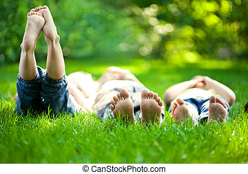 Children having picnic - Group of happy children lying on...
