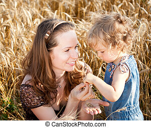 Woman and child in wheat field