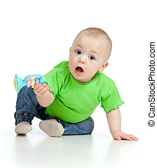 Funny baby  with musical toy. Isolated on white background