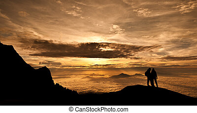 Above the Heavens - Sun rises over Kinabalu Valley, Mt...