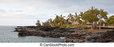Cottages on the lava beach in Hawaii