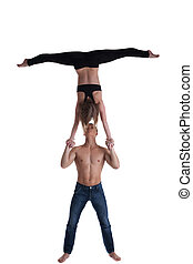 Couple of gymnast show stand on hand