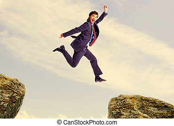 Happy jumping businessman Success in business