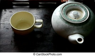 Teapot pouring tea,ancient customs of...