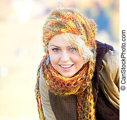 Happy young woman - Portrait of a happy young blonde outdoor...