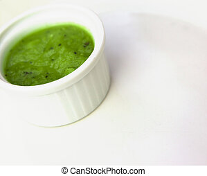 Fresh delicious green sauce in white plate