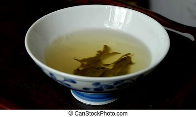 A bowl of shaking tea.china,japan,water,steaming.