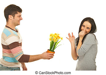 Guy offering flowers to picky woman - Guy offering daffodil...