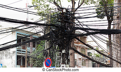 Power line tangle in Saigon Vietnam - Bundles of cables line...