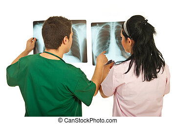 Back of doctors checking X-rays