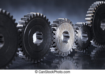 Gears - Old worn metallic cog gear wheels, with one gear in...