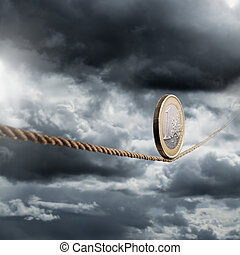 Euro coin balancing on a tightrope