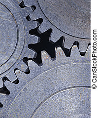 Cog wheels - Three old cog gear wheels in closeup.