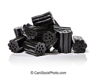 Liquorice - Small pile of black liquorice candies on white