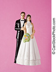 Wedding Figurines towards pink background