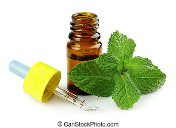 Peppermint oil  - bottle of peppermint oil and fresh min