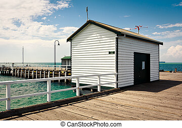 Shed on the pier - white wooden shed on the pier