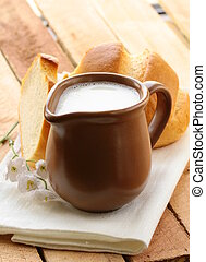 pitcher of milk on a wooden table