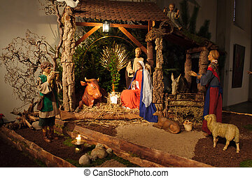 Christmas nativity scene with three Wise Men presenting...