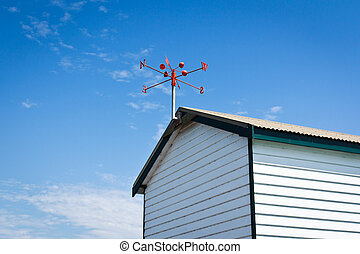 wind vane - red wind vane at the roof top