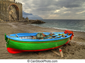 Fishing boat on the beach of Atrani (SA) during a temporal