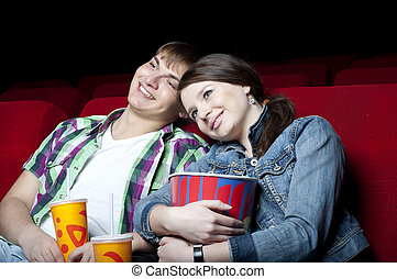 couple in a movie theater, watching