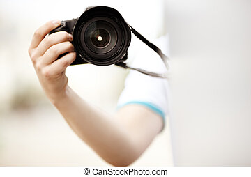 Paparazzi - photography concept ,selective focus on camera