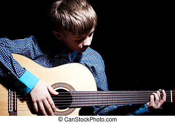 Young Boy Holding Guitar