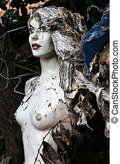 Creepy mannequin doll in an illegal garbage dump Old...