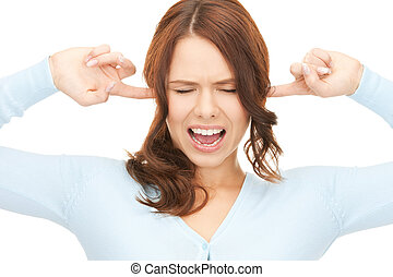 woman with fingers in ears - picture of woman with fingers...