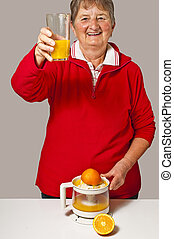 pensioner drinks orange juice