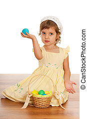 Cheerful little girl with Easter basket