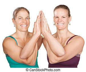 Entwined Namaskar - Two smiling women perform entwined...