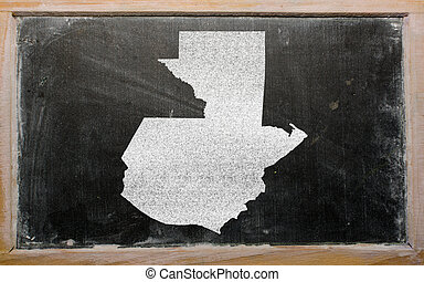 outline map of guatemala on blackboard - drawing of...
